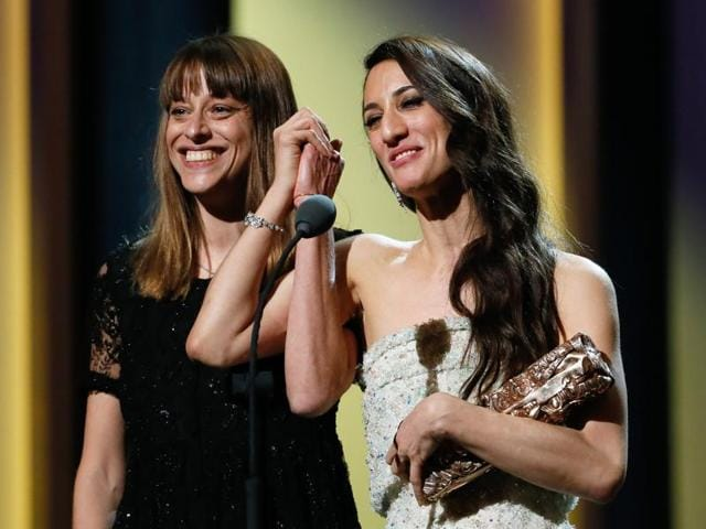 French screenwriter Alice Winocour (L) and French-Turkish director Deniz Gamze Erguven celebrate on stage after winning the Best Original Sreenplay award for Mustang during the 41st edition of the Cesar Ceremony at the Theatre du Chatelet in Paris on February 26, 2016.