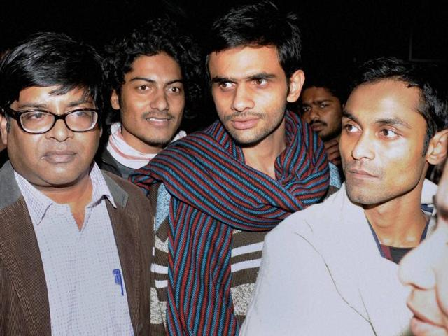 Jawaharlal Nehru University students Umar Khalid (C) and Anirban Bhattacharya (R) who are facing charges of sedition, come out of JNU campus to surrender before the police in New Delhi.