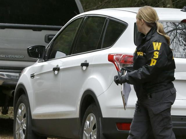 The officer who took the shooter's call went to the home across Puget Sound from Seattle with another deputy.