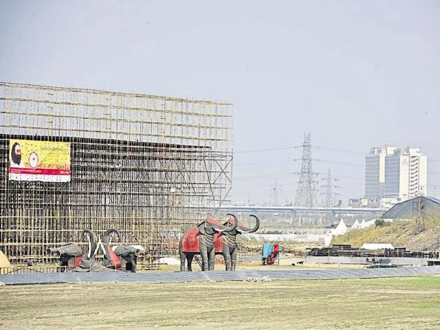Construction of a staging area for an event is underway on the Yamuna bank.