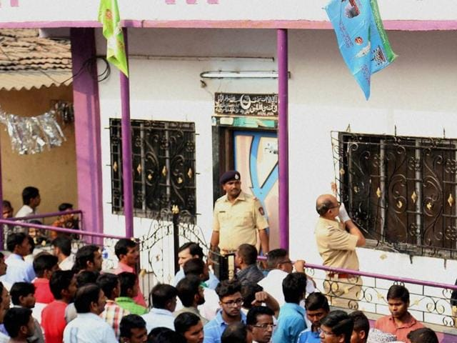 Police inspecting the house where a 35-year-old man killed 14 of his family members and then committed suicide in the Kasarwadavli area in Thane on Sunday.