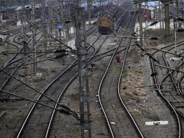 A woman crosses railway tracks in Bhubaneswar, India, Thursday, Feb. 25, 2016. Indian Railways is to boost the amount of tracks it lays every day in 2016-17 as part of its capacity augmentation plan.