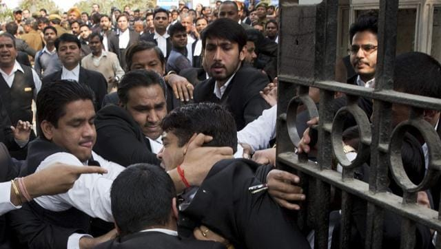 Lawyers assault a journalist outside Patiala House Court in New Delhi on Feb 17. The SC has expressed concern over the standard of lawyers and the Bar Council recently said a third of lawyers may be fake.