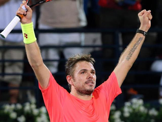 Stan Wawrinka of Switzerland celebrates after defeating Marcos Baghdatis of Cyprus in the final of the Dubai Duty Free Tennis Championships on February 27, 2016.