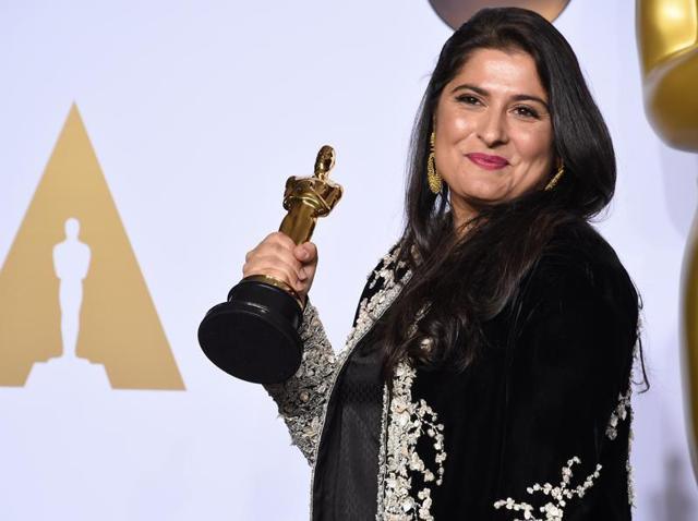 Sharmeen Obaid-Chinoy poses with her Oscar for Best Documentary Short Subject, A Girl in the River: The Price of Forgiveness, during the 88th Oscars in Hollywood on February 28, 2016.