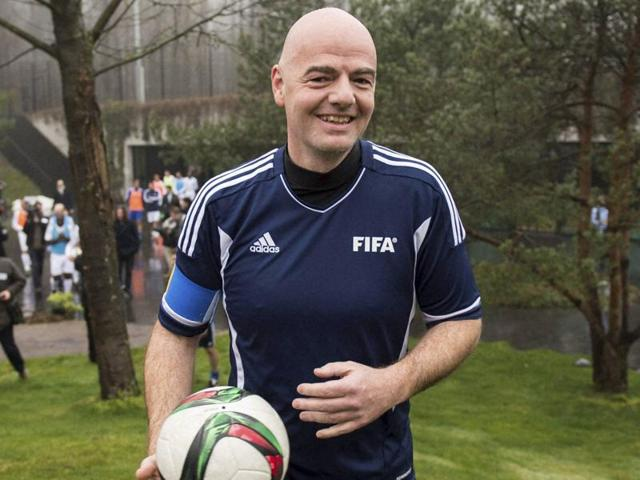 New Fifa President Gianni Infantino arrives with a ball for a friendly soccer match at the home of FIFA in Zurich.