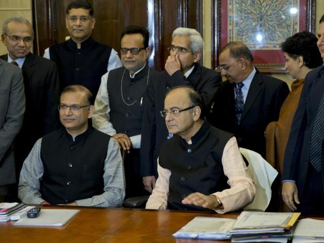 Finance Minister Arun Jaitley, seated right and members of his team pose for a photo on the eve of annual budget presentation in the Parliament in New Delhi, India, Sunday, Feb. 28, 2016.