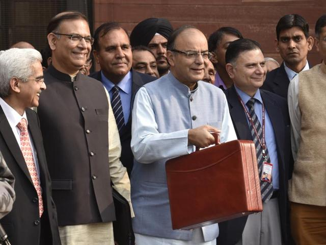 Union finance minister Arun Jaitley with minister of state Jayant Sinha leaving finance ministry North Block to present the General Budget at Parliament House, in New Delhi on Monday.