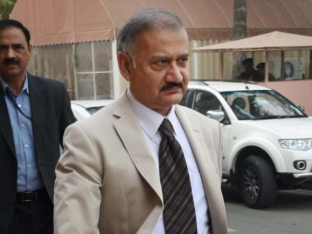 CBI director Anil Sinha leaves after a meeting at Parliament in New Delhi.