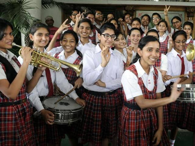 12th standard students give a last look to their notes as they prepare to appear in their CBSE exams .
