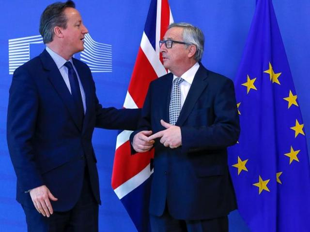Britain's Prime Minister David Cameron is welcomed by European Commission President Jean-Claude Juncker  ahead of a meeting at the EU Commission headquarters in Brussels.