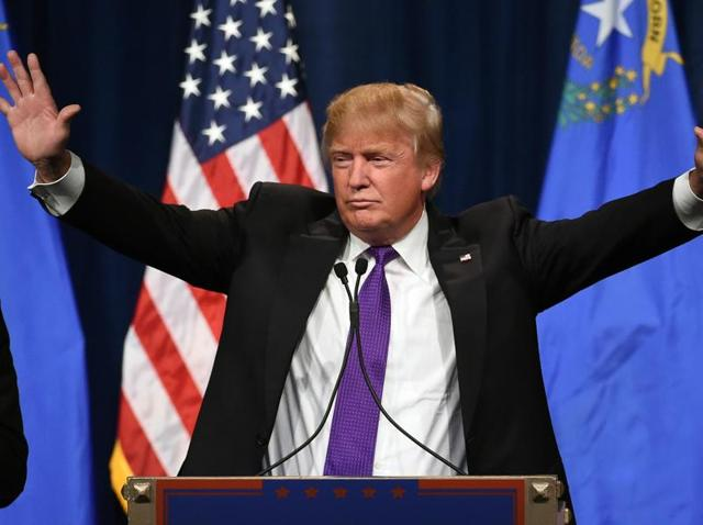 Republican presidential candidate Donald Trump speaks at a caucus night watch party at the Treasure Island Hotel & Casino.