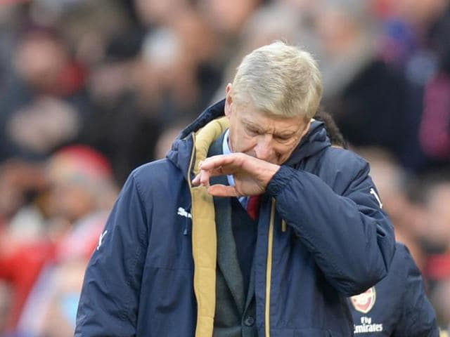 Arsenal coach Arsene Wenger has called on his team to respond positively after his side's title hopes were damaged following a 3-2 loss to Manchester United.