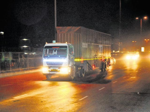 A truck passes through Rajiv Chowk towards Delhi on NH 8. HT found no checkpoints to divert heavy vehicles.
