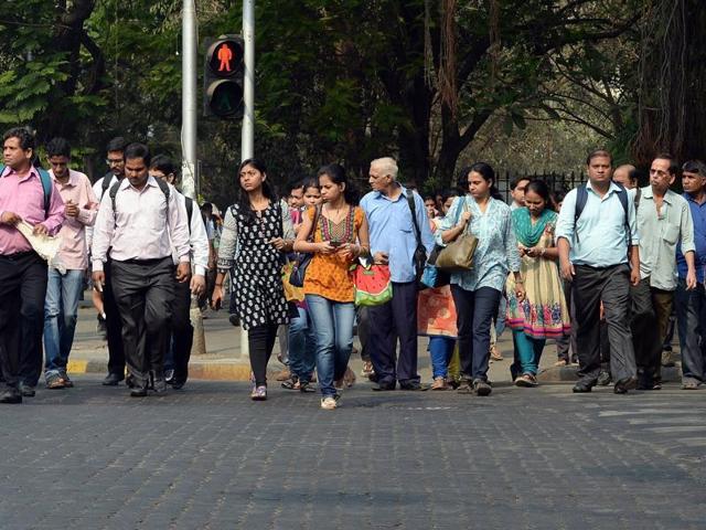 Residents walk at a pedestrian crossing in Mumbai.