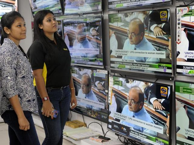 People watch Union Budget 2016-17 presentation by finance minister Arun Jaitely on TV sets at a showroom in Kolkata.