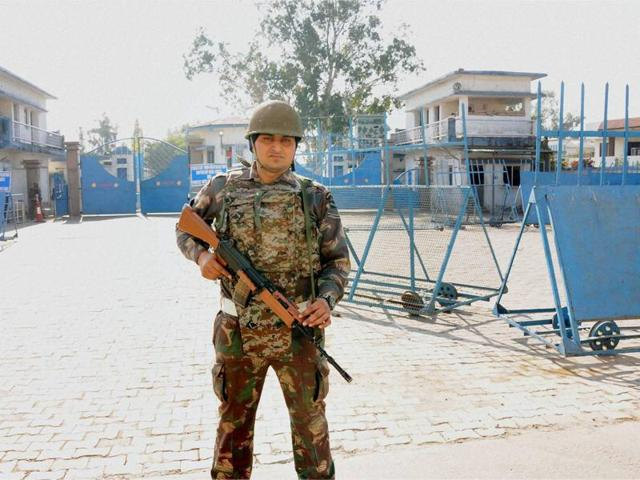 A soldier stands guard outside the Pathankot air base.