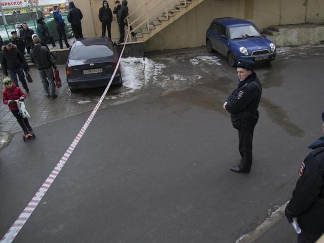 Russian police officers secure an area near to a subway station in Moscow on Monday, Feb. 29, 2016. Russian news agencies report that police have arrested a woman who was waving the severed head of a small child outside a Moscow subway station.