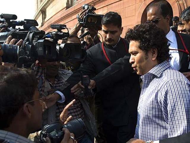 Rajya Sabha MP and former cricketer Sachin Tendulkar speaks to the media outside Parliament in 2015.
