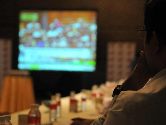 Industrialists and financial experts watching the union budget presentation on the big screen, in Indore on Monday.