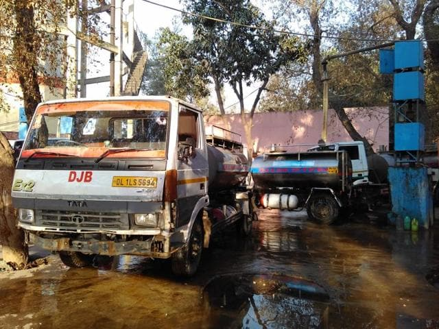 Delhi Jal Board tankers spill water while refilling at the Delhi Jal Board Pumping Station on February 24, 2016