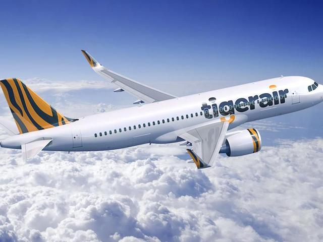 A Tiger Airways jet made an emergency landing in the Australian city of Melbourne on Tuesday  after an odor was detected and crew members were reported ill, the government said.