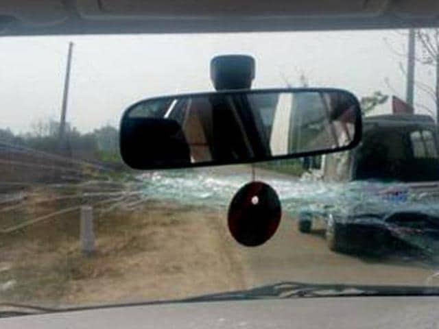 Broken windshield of the car that was attacked when AAP convener and Delhi CM Arvind Kejriwal was in the front seat, at Hasanpur village in Ludhiana on Monday.