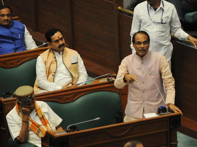 CM Shivraj Singh Chouhan and parliamentary affairs minister Narottam Mishra attend the assembly session during discussion on Budget, in Bhopal on Tuesday.