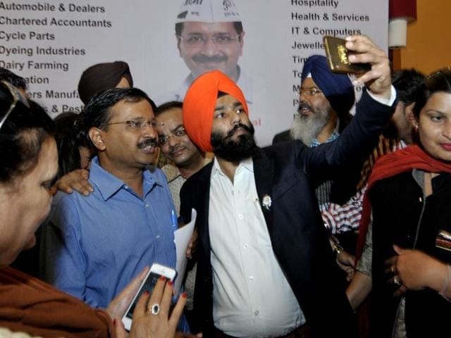 Delhi CM Arvind Kejriwal putting on a muffler gifted  to him by an Industrialist in Ludhiana on Monday.