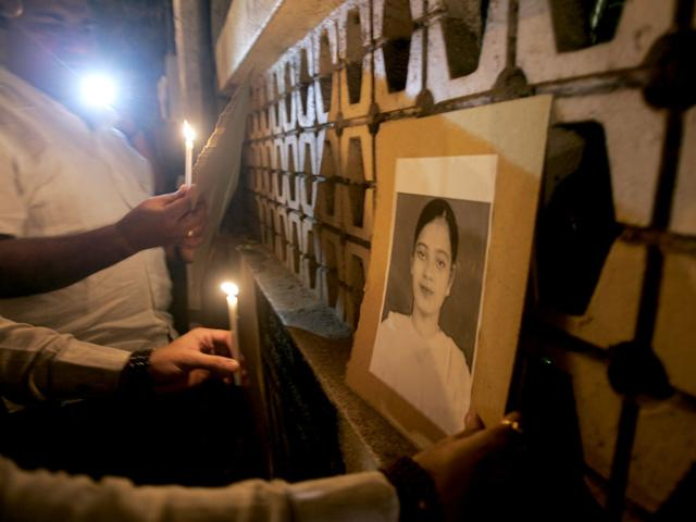 A file photo of demonstrators holding a candlelight vigil for Ishrat Jahan, the 19-year-old Mumbra student, was shot dead in Gujarat in 2004.