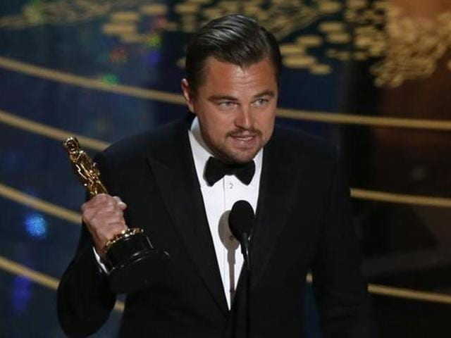 Leonardo DiCaprio holds the Oscar for Best Actor for the movie The Revenant at the 88th Academy Awards in Hollywood. He then left it behind.