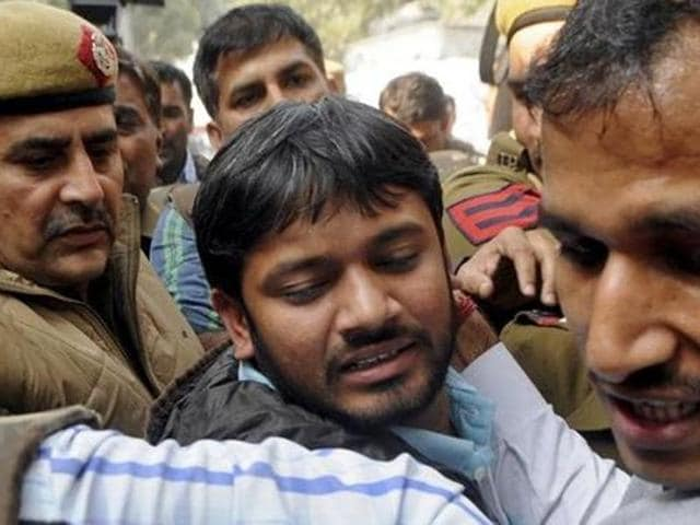 JNUSU president Kanhaiya Kumar (C), is escorted by police outside the Patiala House court in New Delhi