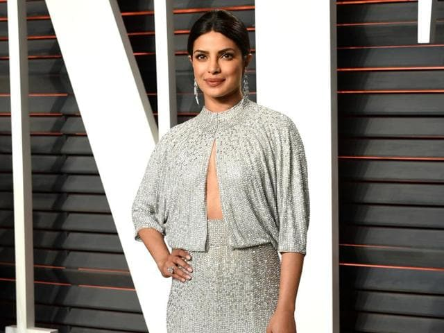 Priyanka Chopra wore a crystal embellished Jenny Packham gown and teamed it up with centre-parted pony look and muted makeup.