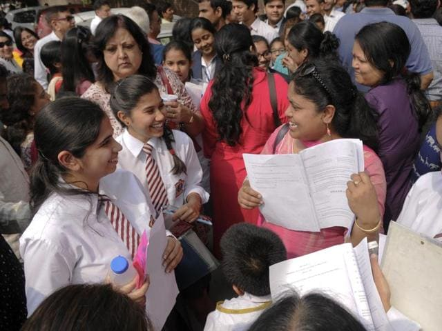 Class 12 students coming out from an examination centre after writing their CBSE English paper in Noida on Monday.