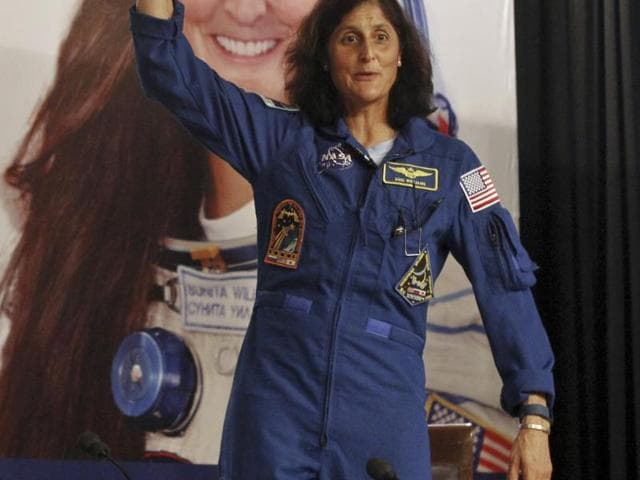 Sunita Williams, an American astronaut, waves to crowds during a visit to New Delhi, India.