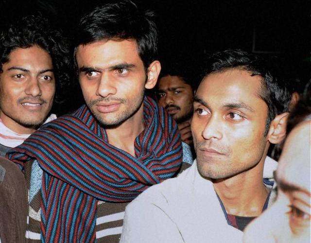 Jawaharlal Nehru University students Umar Khalid (C) and Anirban Bhattacharya (R) were sent to 14 day judicial custody on Tuesday.