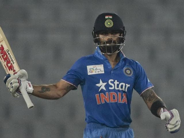 India's Virat Kohli acknowledges the crowd after scoring fifty runs during the Asia Cup Twenty20 tournament.