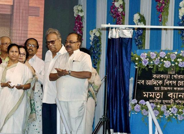 West Bengal Chief Minister Mamata Banerjee with Mayor Sovan Chatterjee and Satyajit Ray's son Sandeep Ray during the inauguration of beautification of Bishop Lefroy Road, in Kolkata on Monday.