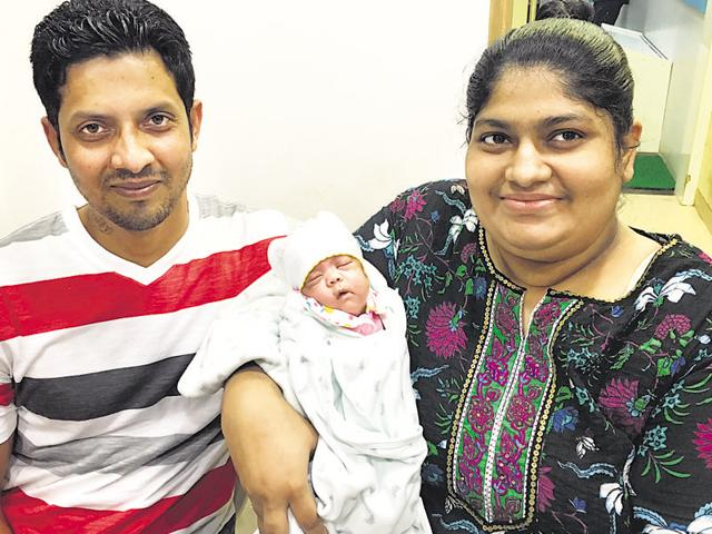 James and Reena with their daughter Infinity, who they took home after 12 weeks in the hospital.