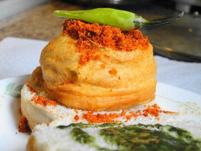 A Shiv Sena worker was arrested for allegedly assaulting a Vile Parle shopkeeper's employee, who refused to supply free vada pavs for a cricket tournament organised by the party.