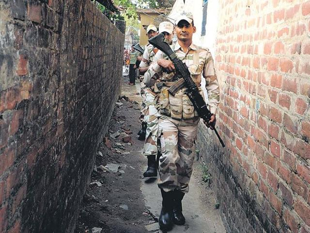 Central forces patrol a lane in Kolkata on Tuesday. Over 100 companies will arrive in the state ahead of the assembly polls.