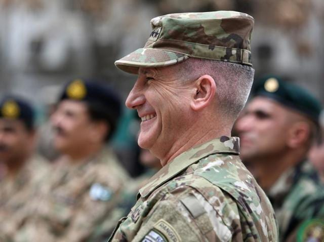 US Army Gen John Nicholson, the new commander of Resolute Support forces and US forces in Afghanistan, walks during a change of command ceremony in Kabul, Afghanistan.