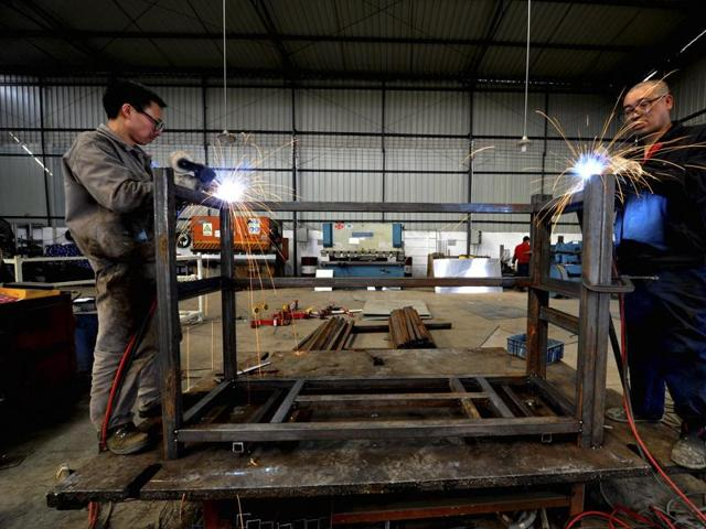 Moody's cuts China outlook to 'negative', cites reform and fiscal risks