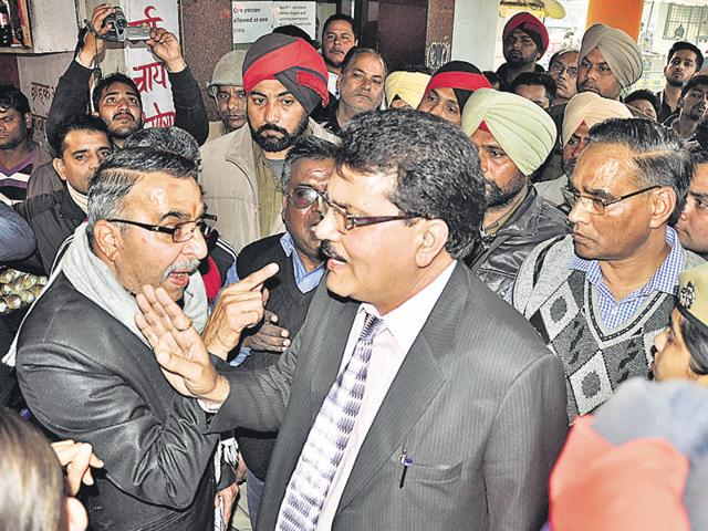 Shop keepers arguing at the Ludhiana bus stand on Wednesday.