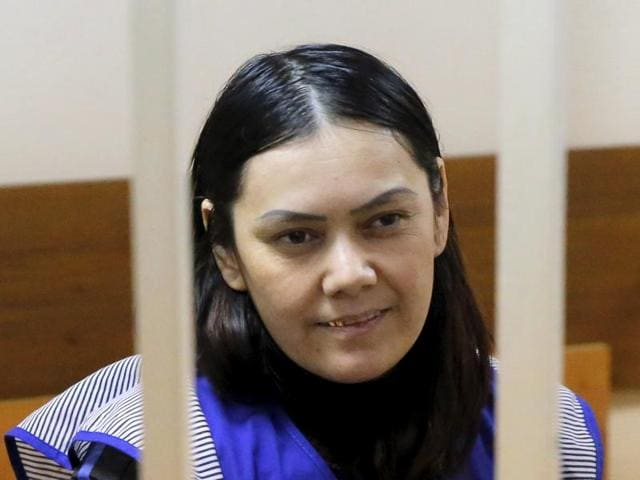 Gyulchekhra Bobokulova, a nanny accused of beheading a child in her care, sits inside a defendants' cage in a court hearing in Moscow on Wednesday.