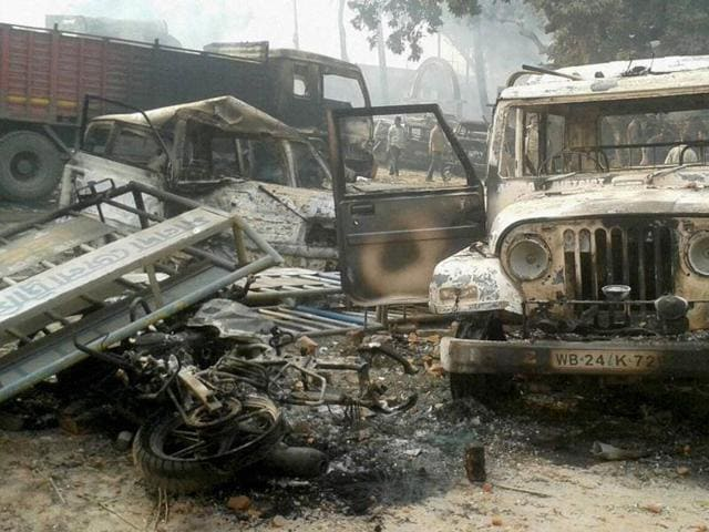 Vehicles set on fire after clashes between two groups at Kaliachak police station in Malda.