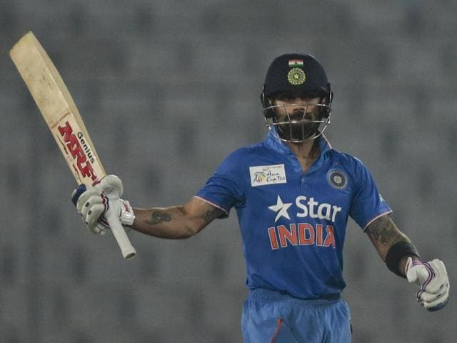 India's Virat Kohli acknowledges the crowd after scoring fifty runs during the Asia Cup T20 match against Sri Lanka in Dhaka on March 1, 2016.