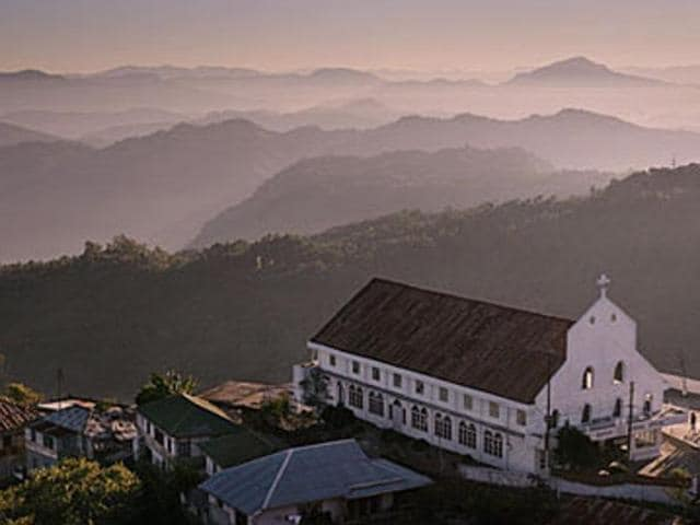 The untouched northeast: first-hand accounts of the state of Mizoram are rare. A world of contradictions, it is unpretentious, remote, and yet— in Aizawl at least— modern and 'accessible'. In this photo: The Baptist Church at Zotlang, Lunglei.