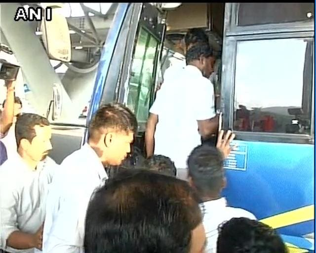 Indian Fishermen released by Iran board a bus in Chennai.