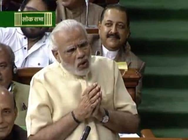 New Delhi: Prime Minister Narendra Modi speaks in Lok Sabha during the second day of winter session of Parliament in New Delhi on Friday. PTI Photo / TV GRAB (PTI11_27_2015_000234A)